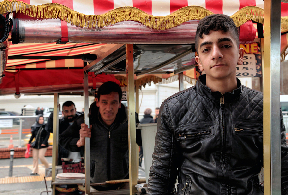 Day 13 —Eminönü - These three lads work on day-wages 6 days a week.