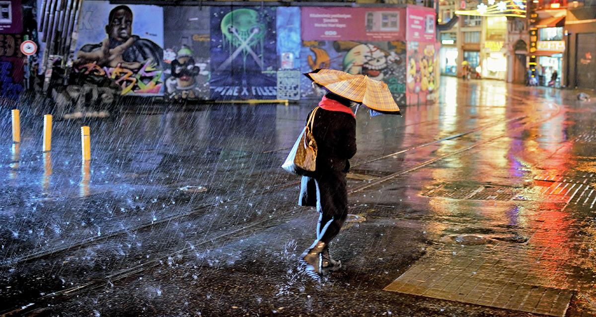#85 —Beyoğlu -  Galatasaray Square. Night, rainfall and a woman.