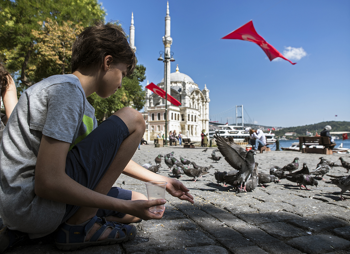 Day 207 —Ortaköy -  An İstanbul tradition ''feeding the pigeons''.
