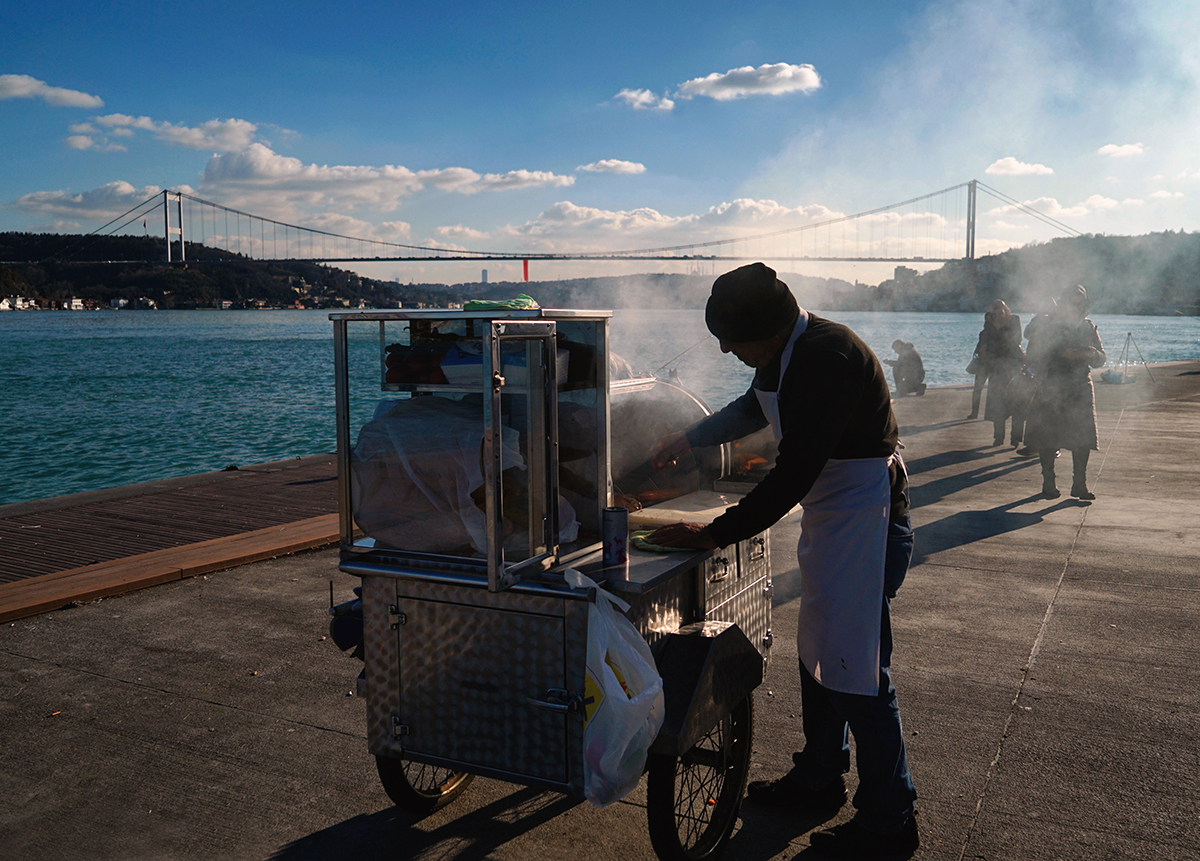 """Day 349 —Emirgan – This vendor quipped, """"What difference does my name make?  30 years ago I left my village and now everyday I make Kokoreç (lamb intestines) and sell it on the streets of Istanbul."""""""